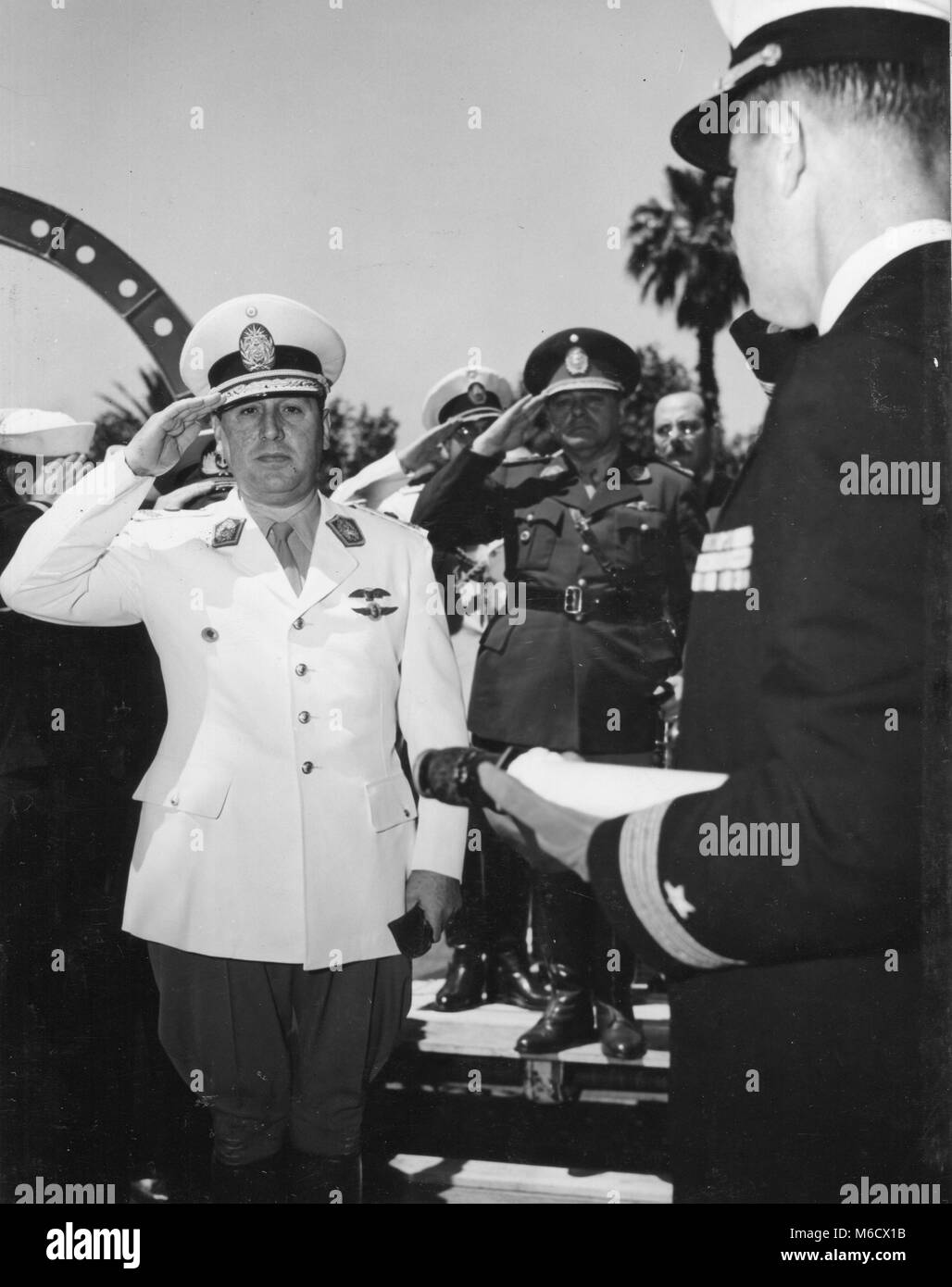 Juan Peron, President of Argentina, is shown receiving honors as he came aboard the USS HUNTINGTON on a good will - Stock Image