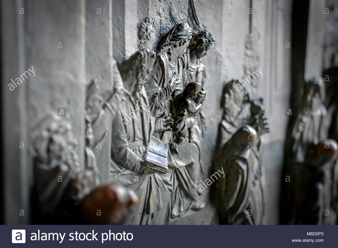Close up of the Bronze relief sculpture of the virgin Mary by Bonanno da Pisa on the front of the Duomo cathedral - Stock Image