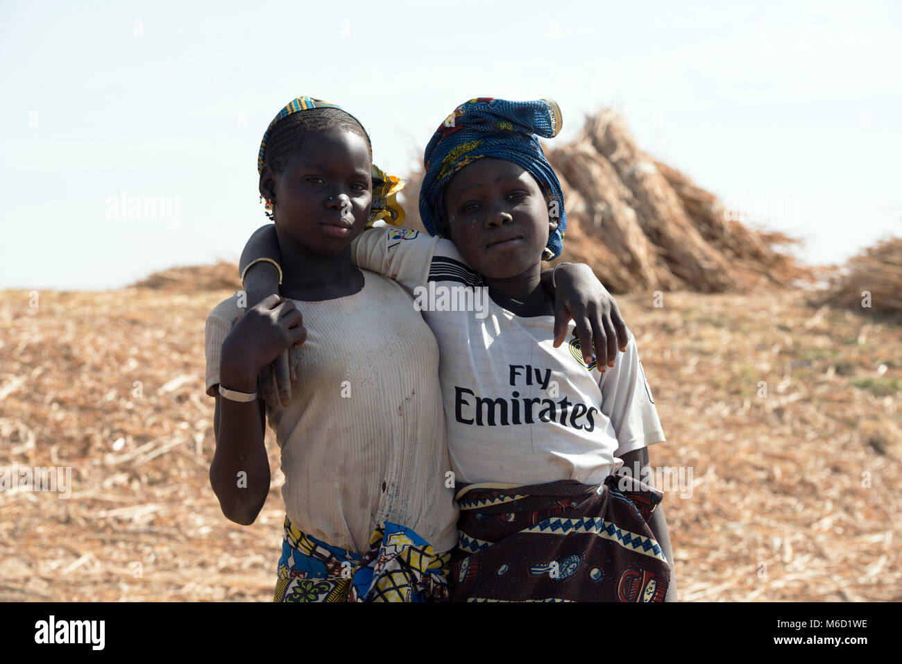 Two young, ethnic, indigenous Bozo tribe girls. Mali, West Africa. - Stock Image