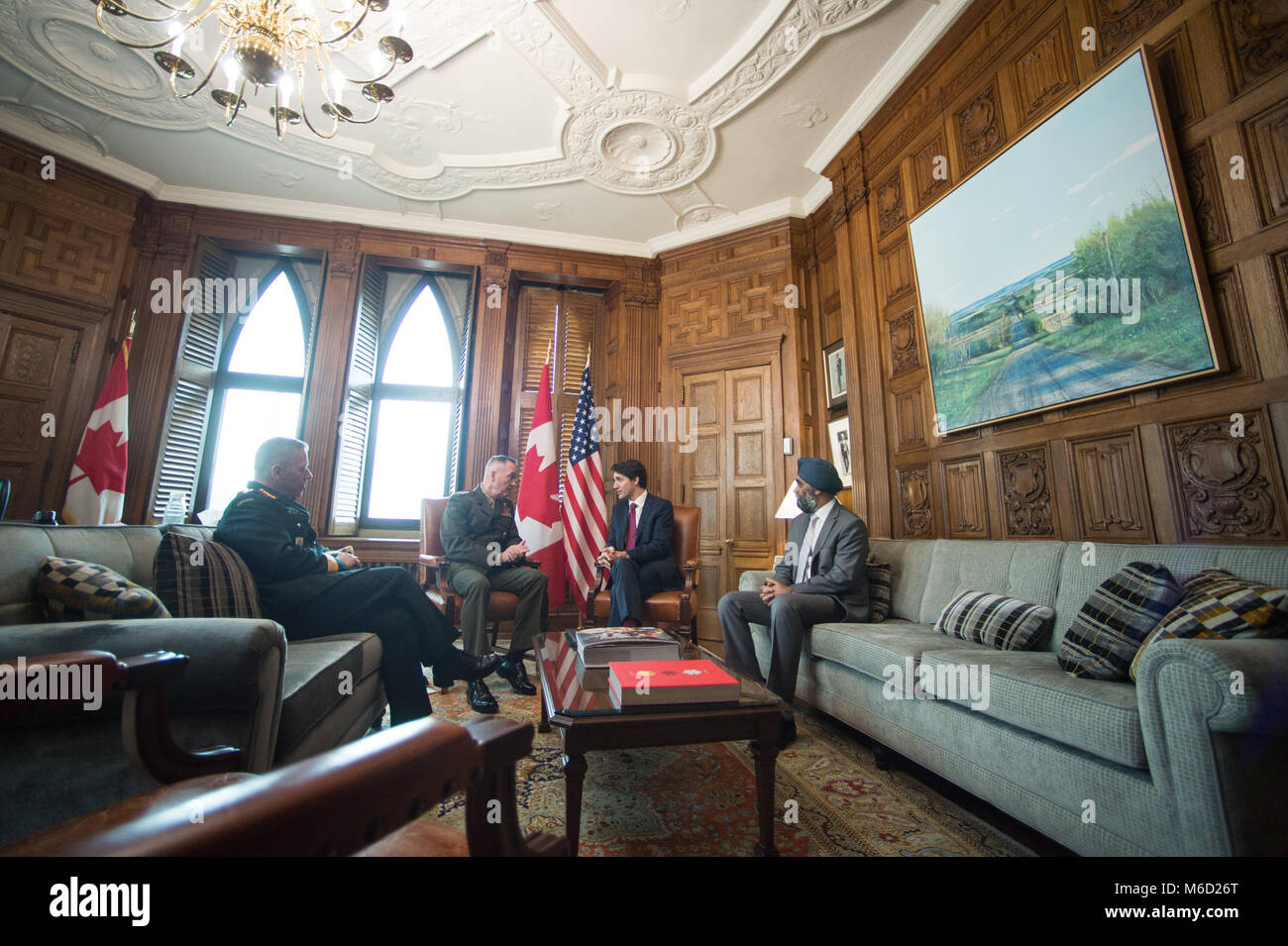 Justin Trudeau, center right, Prime Minister of Canada, meets with U.S. Marine Corps Gen. Joe Dunford, center left, chairman of the Joint Chiefs of Staff, Canadian Gen. Jonathan Vance, left, Canadian Armed Forces Chief of Defence Staff, and Harjit Singh Sajjan, right, Canadian Minister of National Defence, in his office in the Canadian Parliament buildings, Ottawa, Canada, Feb. 28, 2018. Gen. Dunford was in Ottawa for meetings with senior Canadian officials on the ongoing evolution of the North American Aerospace Defense Command. (DoD Photo by U.S. Army Sgt. James K. McCann) Stock Photo