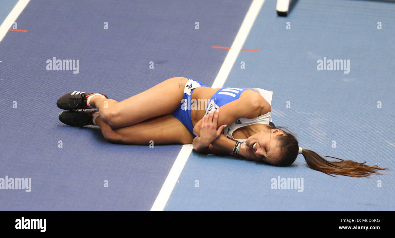 Birmingham, UK. 2nd March, 2018. Elisavet PESRIDOU (Greece) lies on the track in pain after falling hard during - Stock Image