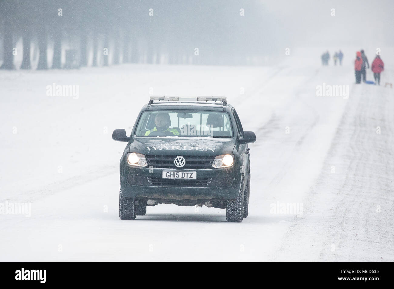 Windsor, UK. 2nd Mar, 2018. A warden drives along a snow-covered Long Walk in Windsor Great Park. Credit: Mark Kerrison/Alamy Stock Photo