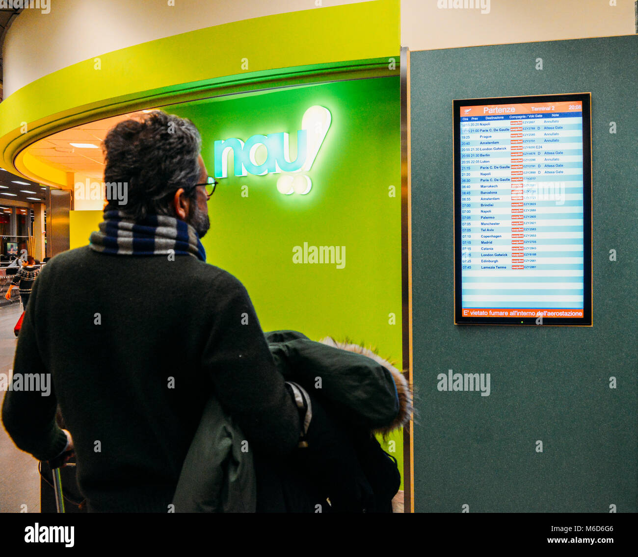 Milan, Italy. 2nd March, 2018. Milan Malpensa Airport - Mar 2nd, 2018: Male passenger looks at the flight information - Stock Image