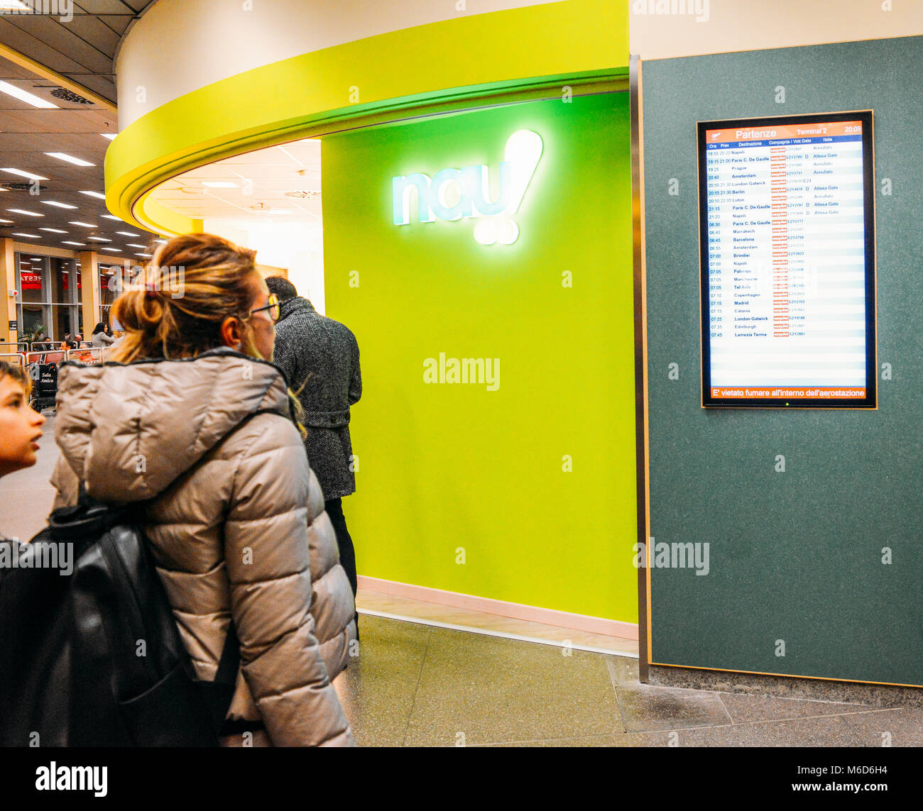 Milan, Italy. 2nd March, 2018. Milan Malpensa Airport - Mar 2nd, 2018: Female passenger and young boy look at the - Stock Image
