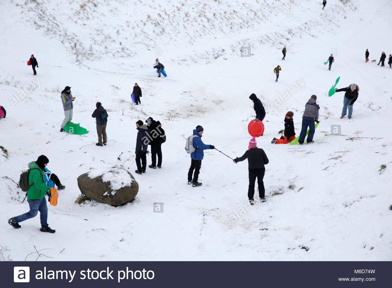 Edinburgh, United Kingdom. 2nd March, 2018. Winter snowfall affecting Arthur's Seat and Holyrood Park. Walkers - Stock Image
