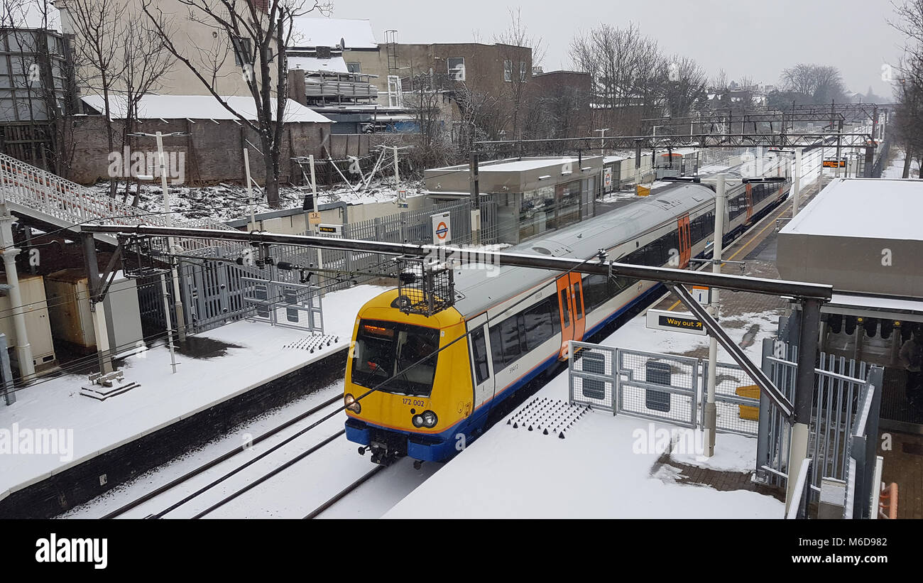 LONDON, UK - March 2: A Overground line train bound for Gospel Oak on tracks covered with snow after heavy snowfall - Stock Image