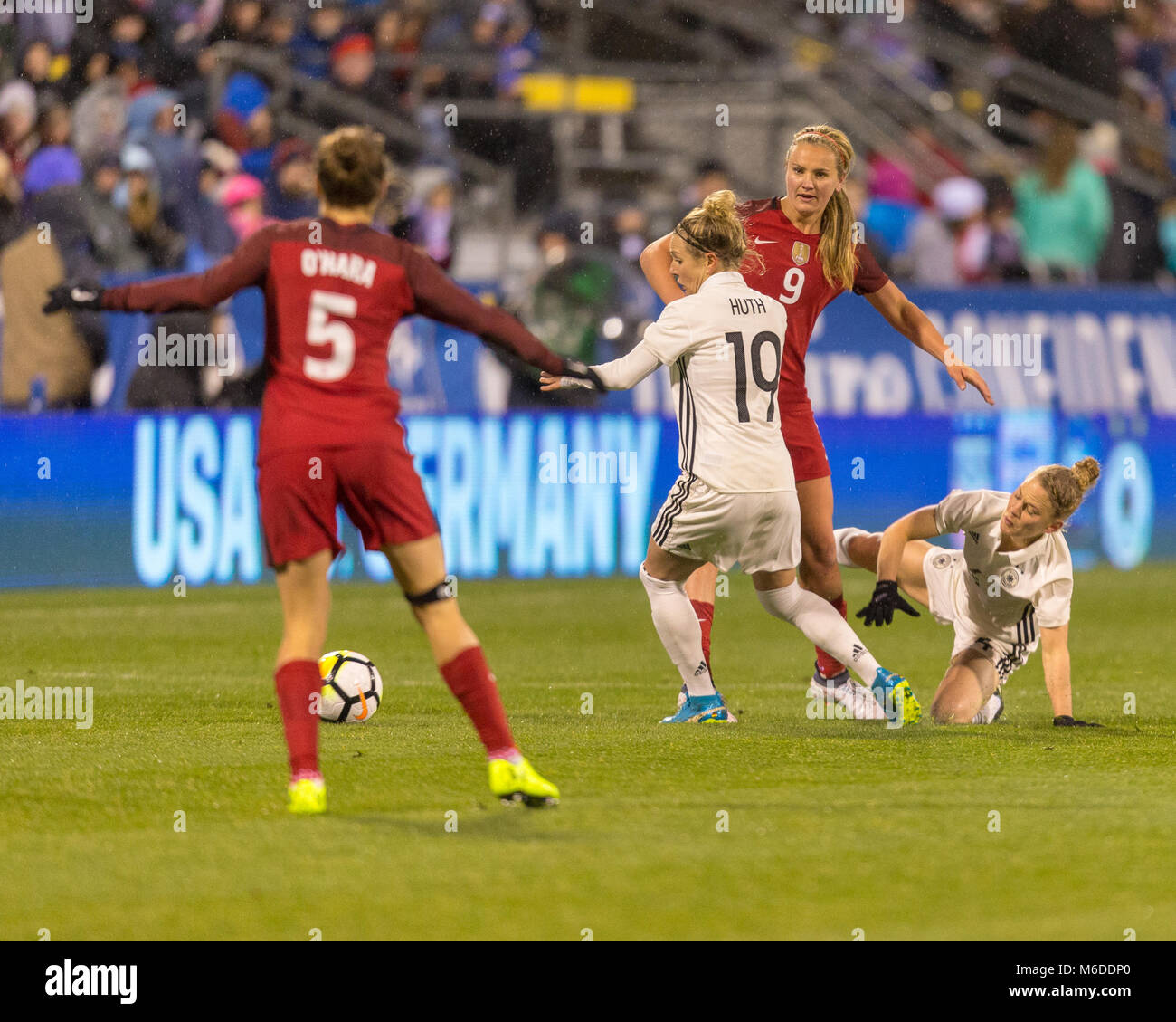 German FW Svenja Huth scrambles for the ball after her teammate looses possesion - Stock Image