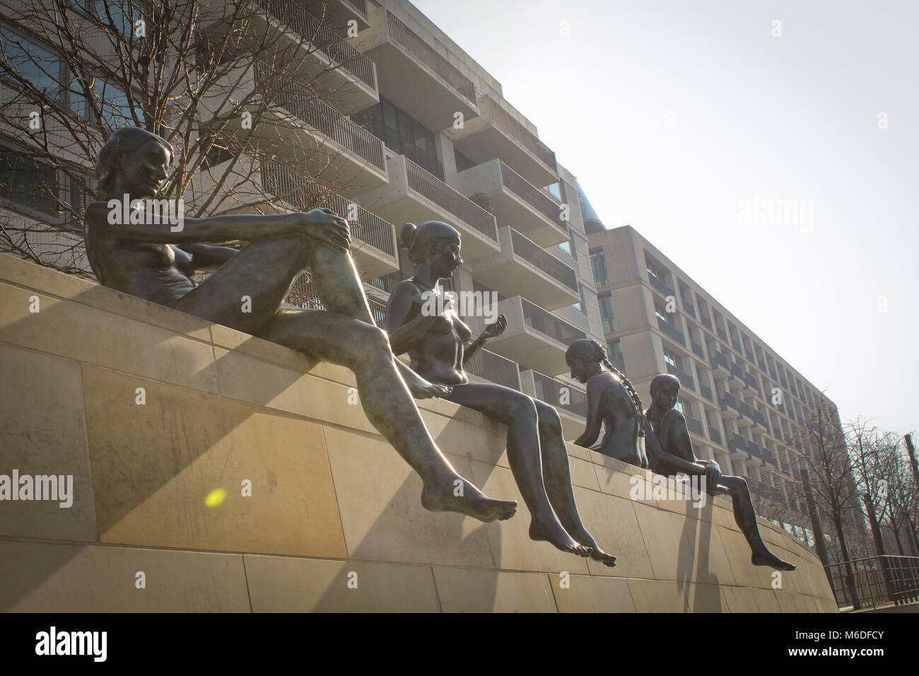 three Girls and a Boy, iconic sculpture in Berlin across the River Spree, original name Drei Maedchen und ein Knabe - Stock Image
