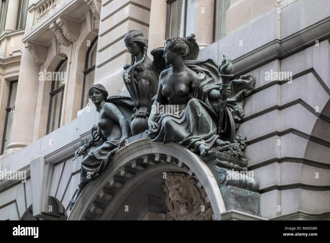 Bronze figures sculpture over entrance 24 - 28 Lombard Street, City of London, UK. 1910 - Stock Image
