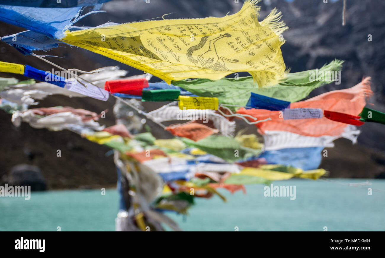 Prayer Flags floating in the wind - Stock Image