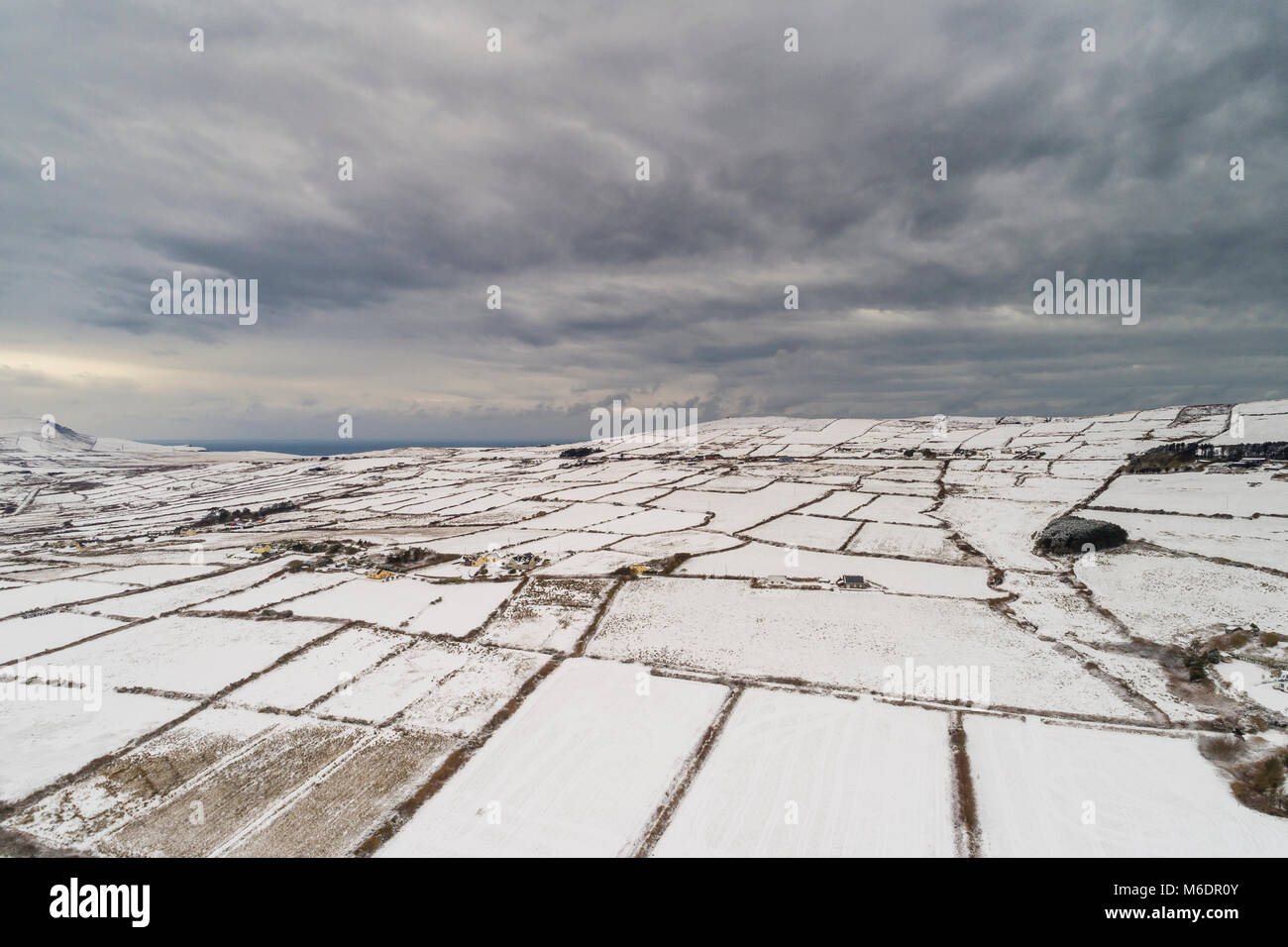 Aerial View of Valentia Island, County Kerry, covered in snow during storm Emma. - Stock Image