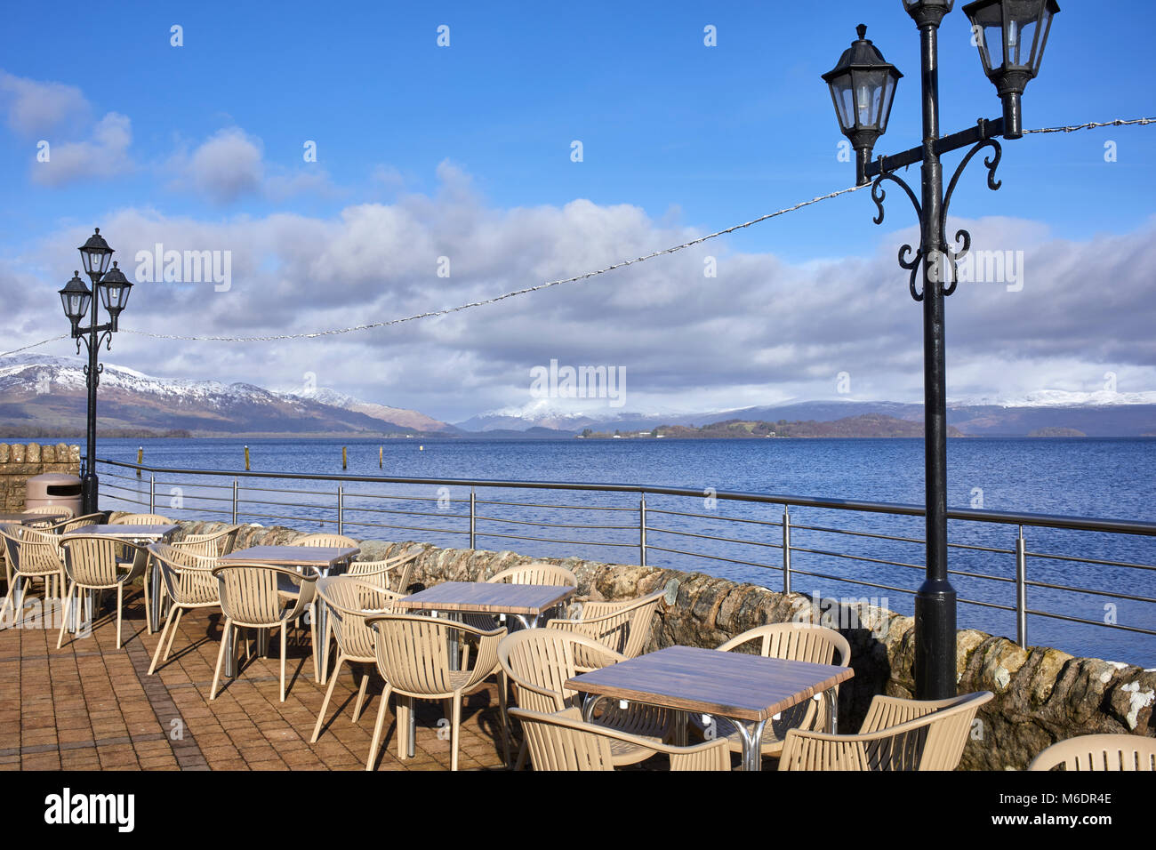 A bright, sunny and welcoming stop at Duck Bay on the shore of Loch Lomond. Northwards towards Inchmurrin and snowcapped - Stock Image