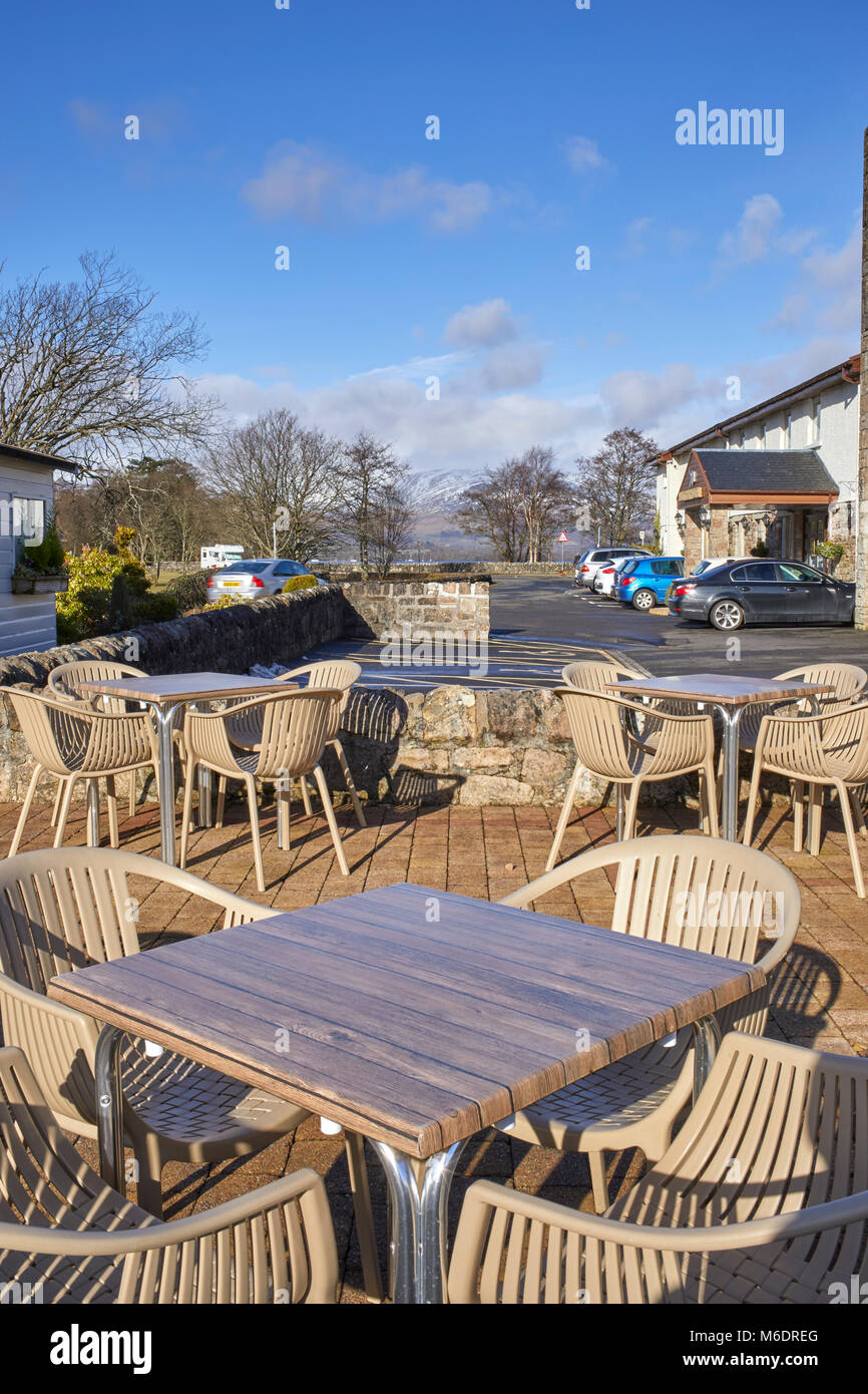 A bright, sunny and welcoming stop with outside tables and chairs at Duck Bay on the shore of Loch Lomond - Stock Image
