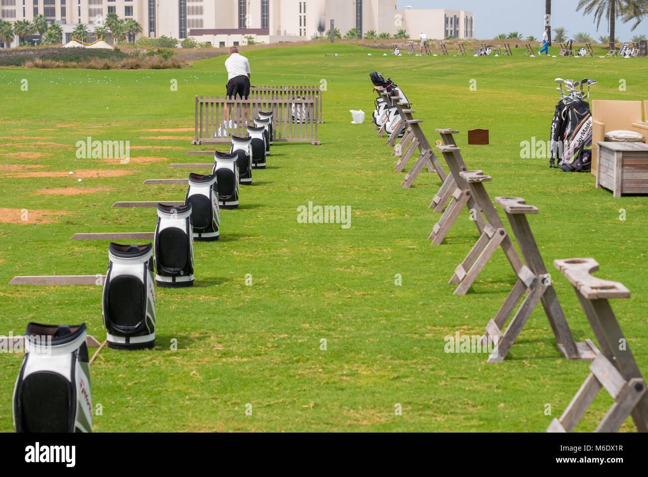 Golf Bags artistically arranged in a row at Saadiyat Beach Golf Course Abu Dhbai. - Stock Image