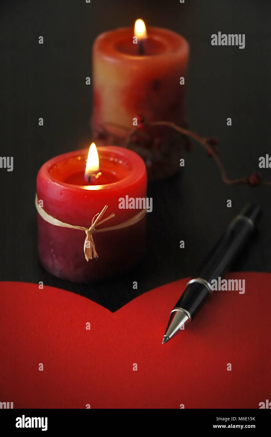 Detail of love letter with pen and candles - Stock Image