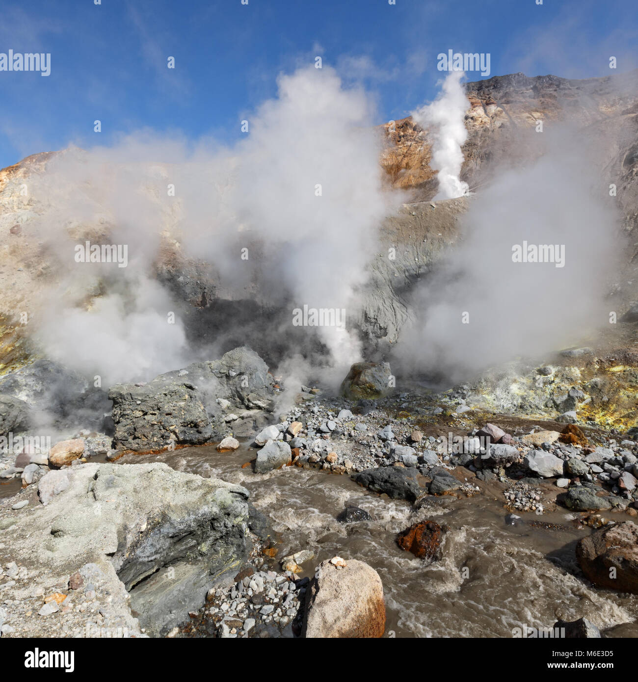 Scenery summer volcanic landscape of Kamchatka: geothermal, volcanic activity in crater of active volcano - hot - Stock Image
