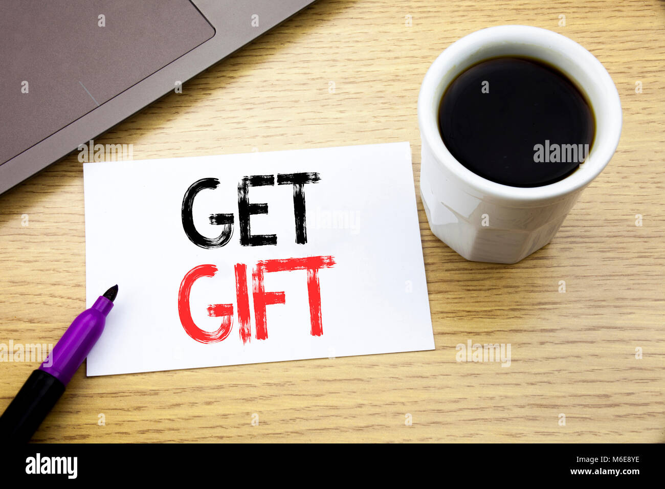 Handwriting Announcement text showing Get Gift. Business concept for Free Shoping Coupon written on notebook book - Stock Image