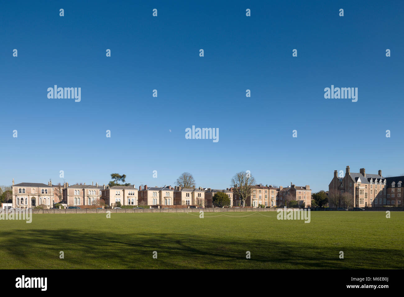 Substantial Victorian semi-detached houses in College Fields, Clifton, Bristol, UK viewed across Clifton College - Stock Image