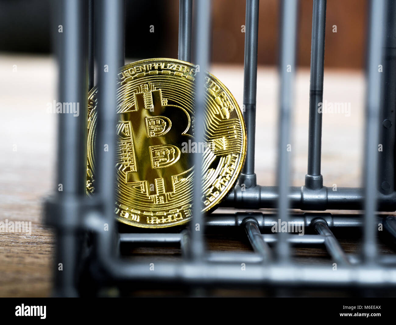 The coin is in the gray nick color put on a wooden table. The concept of investment and fluctuation of bitcoin and - Stock Image