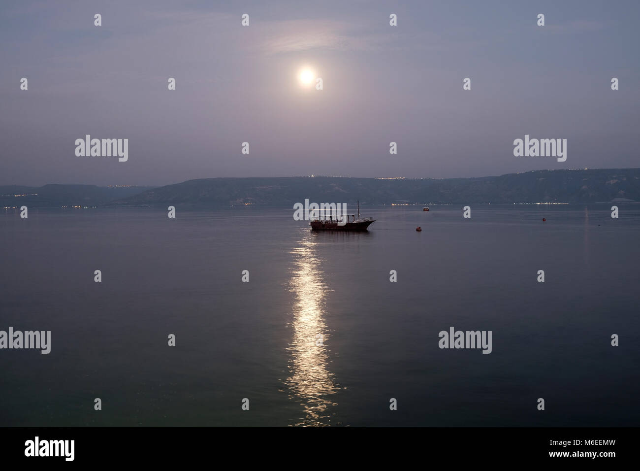 Full moon shines over the Sea of Galilee northern Israel Stock Photo