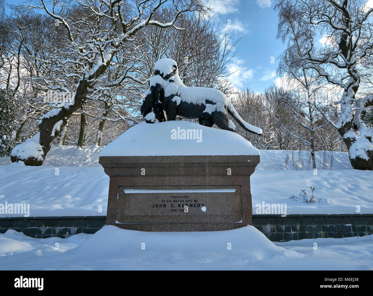 Statue of Lioness (with cubs and peacock) covered in snow on a sunny day Kelvingrove park glasgow Stock Photo