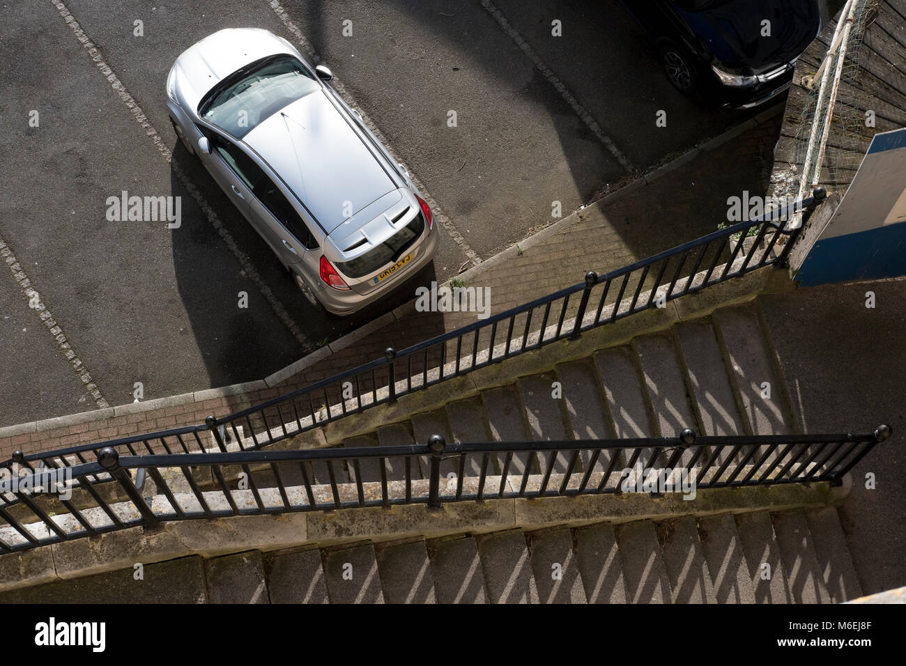 View looking down from top of steps overlooking Ramsgate Harbour onto the carpark beside the Sailors Church. - Stock Image