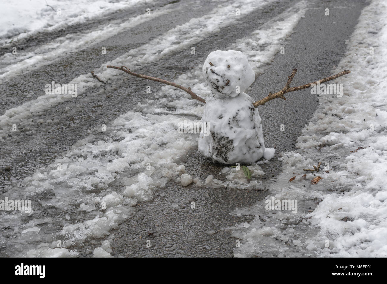 Snowman in middle of country road during the 2018 Beast from the East polar vortex snow conditions which caused - Stock Image