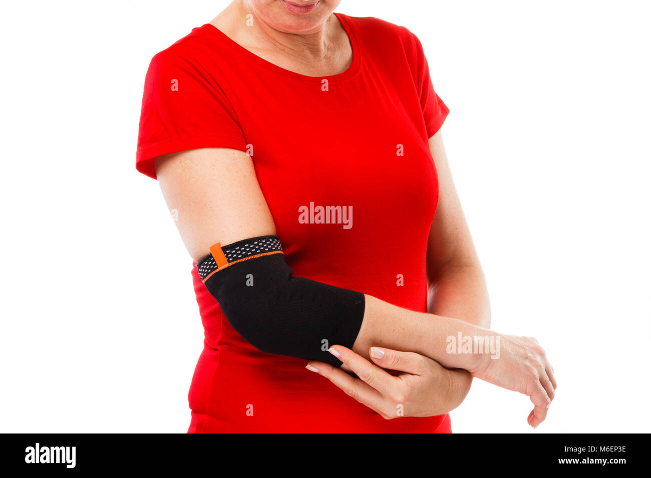 Tennis elbow - woman holding painful elbow isolated on white background - Stock Image