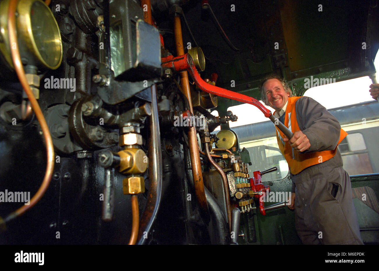 Minehead, UK. Driving a steam engine at the West Somerset Railway in Minehead, Somerset. - Stock Image