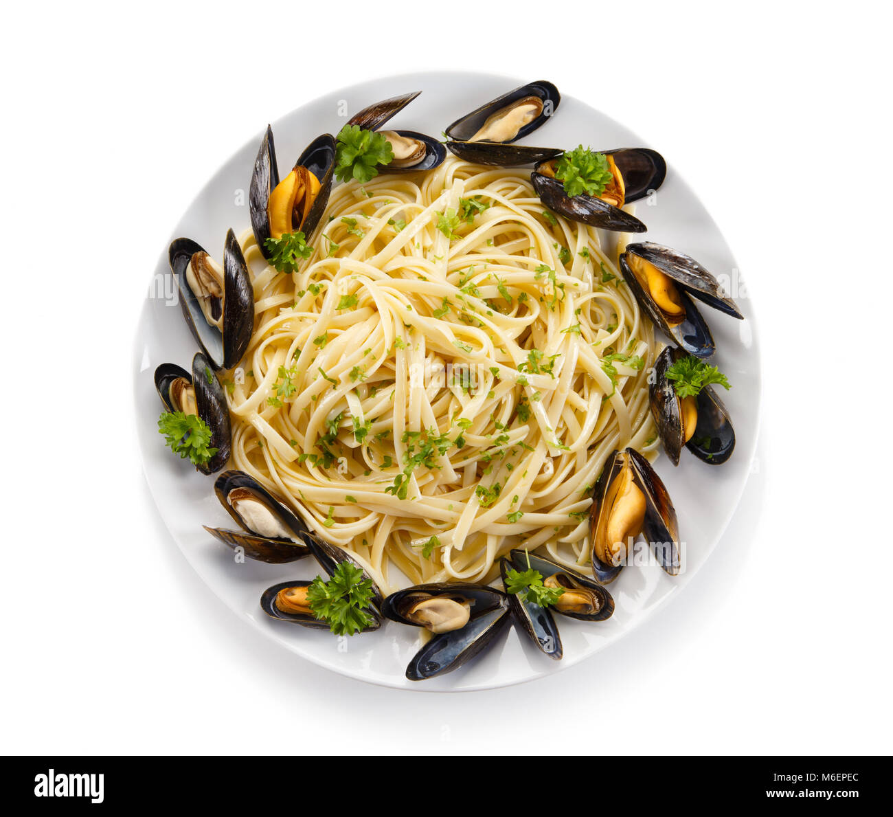 Cooked mussels and pasta on white background Stock Photo