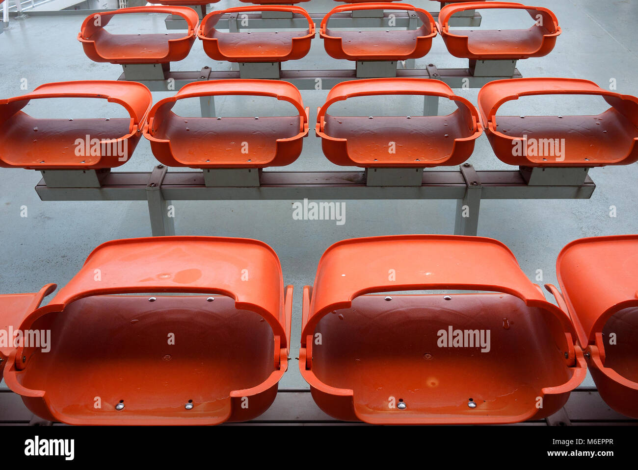 Fold down plastic seating on La Gironde at Royan in France. - Stock Image