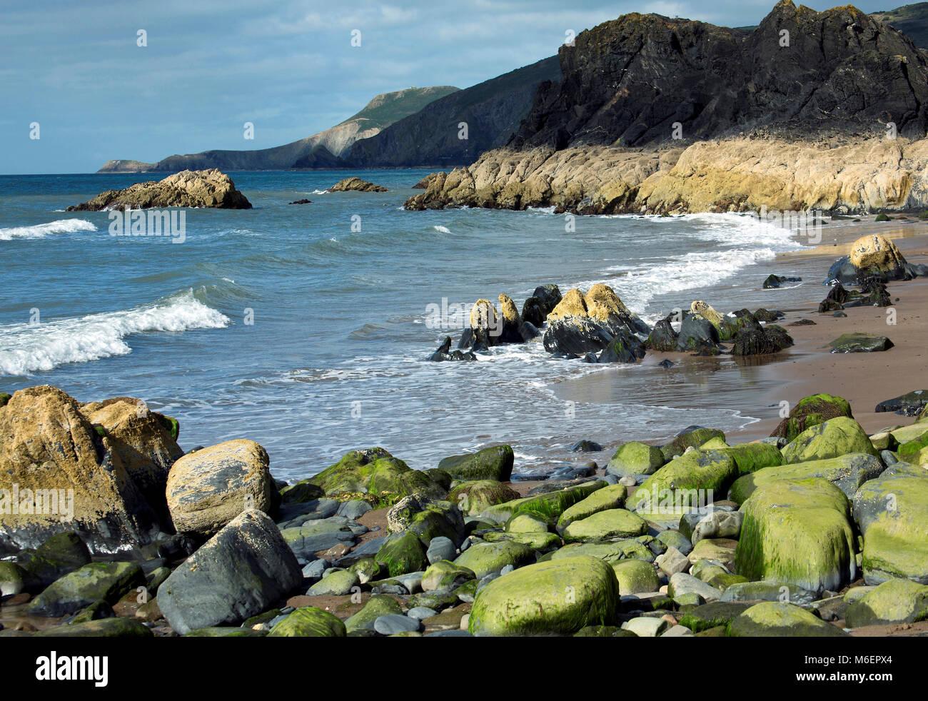 Seashore and coastline at the rock strewn part of Tresaith Beach in Cardigan Bay Wales - Stock Image