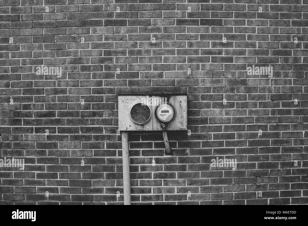 Energy Meter on a Brick Wall Exterior - Stock Image