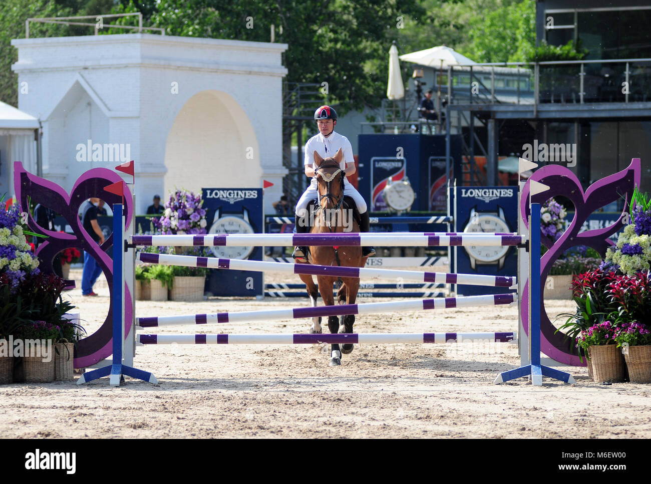 A competitor prepares to jump at the FEI jumping event in Chaoyang park, Beijing, China, in October 2017 Stock Photo