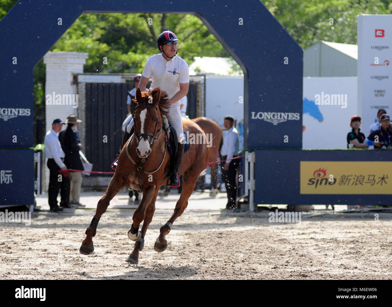 A horse and rider compete at the FEI jumping event in Chaoyang park, Beijing, China, in October 2017 Stock Photo