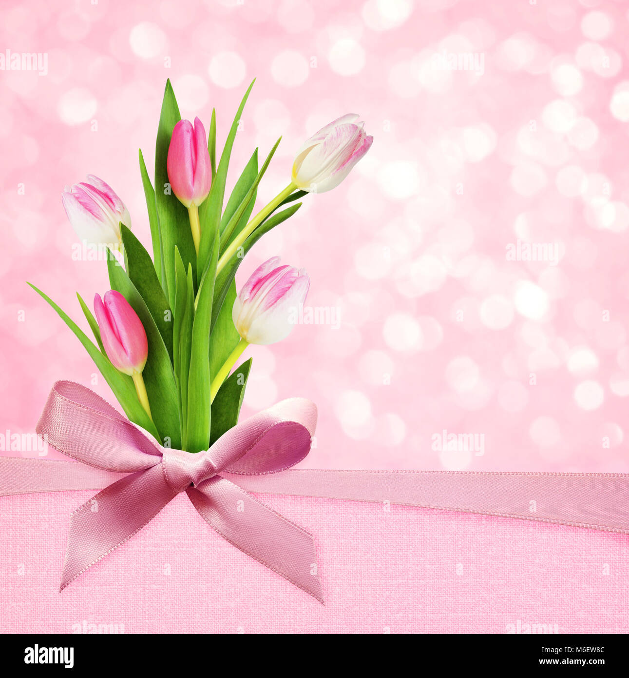 Beautiful tulips silk copy space stock photos beautiful tulips pink holiday bokeh background with silk bow and tulip flowers bouquet stock image izmirmasajfo