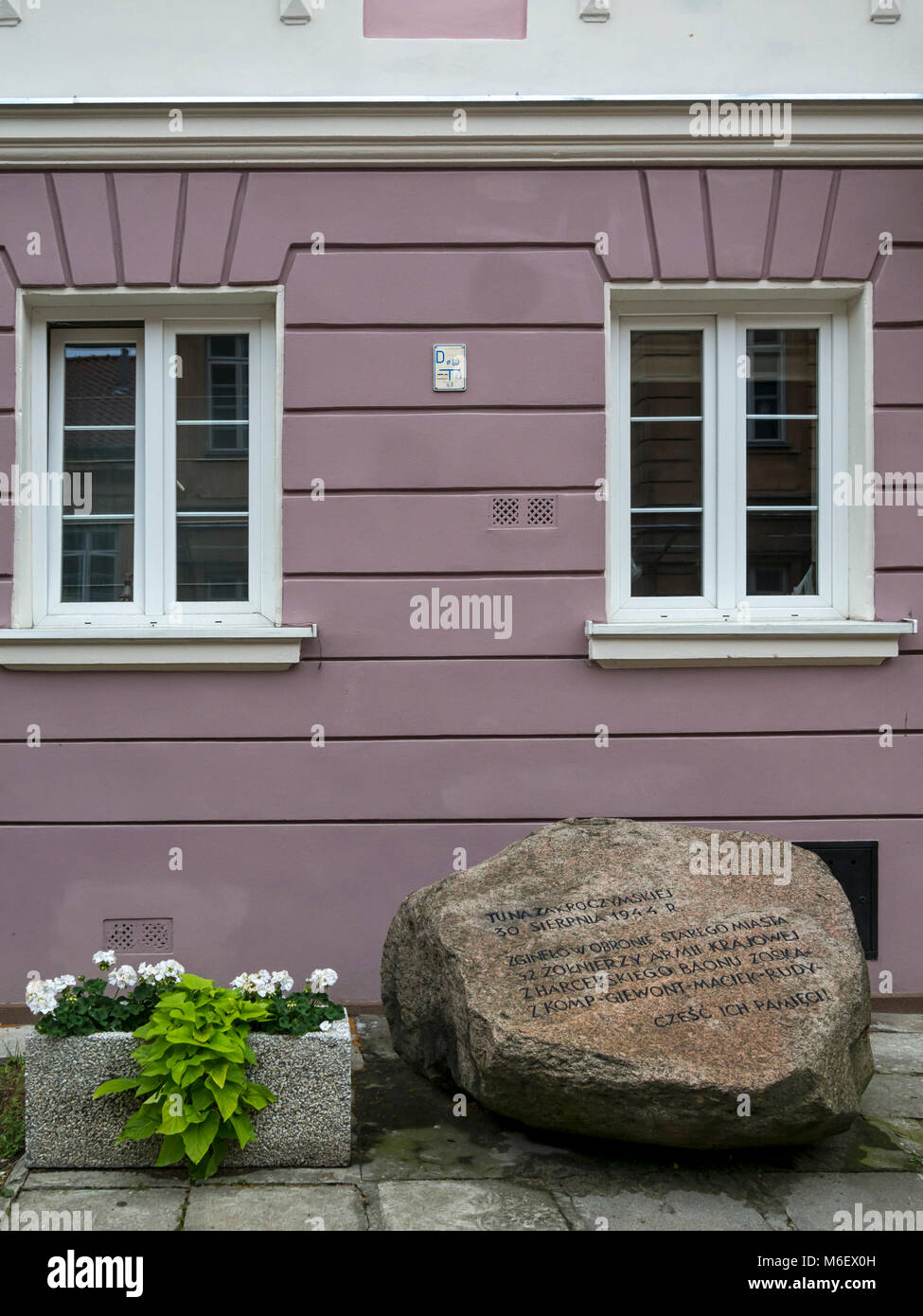 WARSAW, POLAND:  One of the many plaques which commemorate events during the Warsaw Uprising in 1944 during WW2 Stock Photo