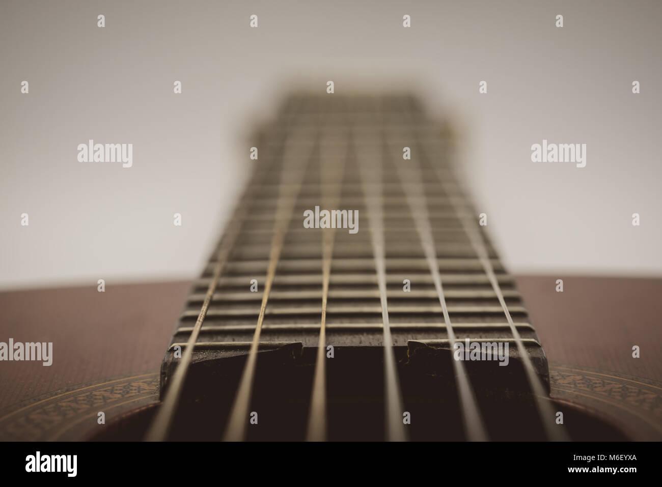 Nylon & steel strung spanish guitar isolated on white background - Stock Image