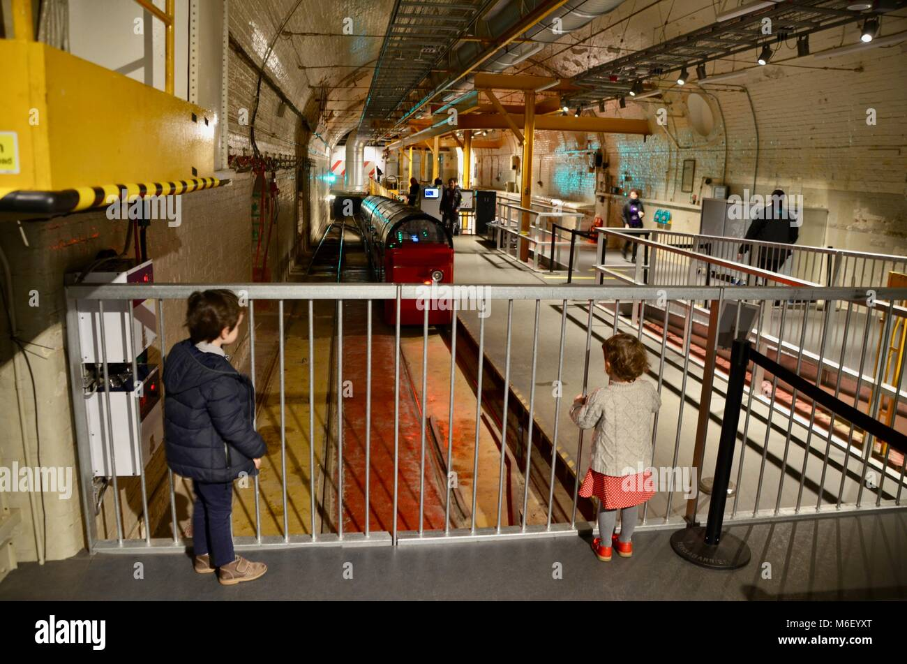 two children watch the train at postal museum mount pleasant north london england great britain - Stock Image