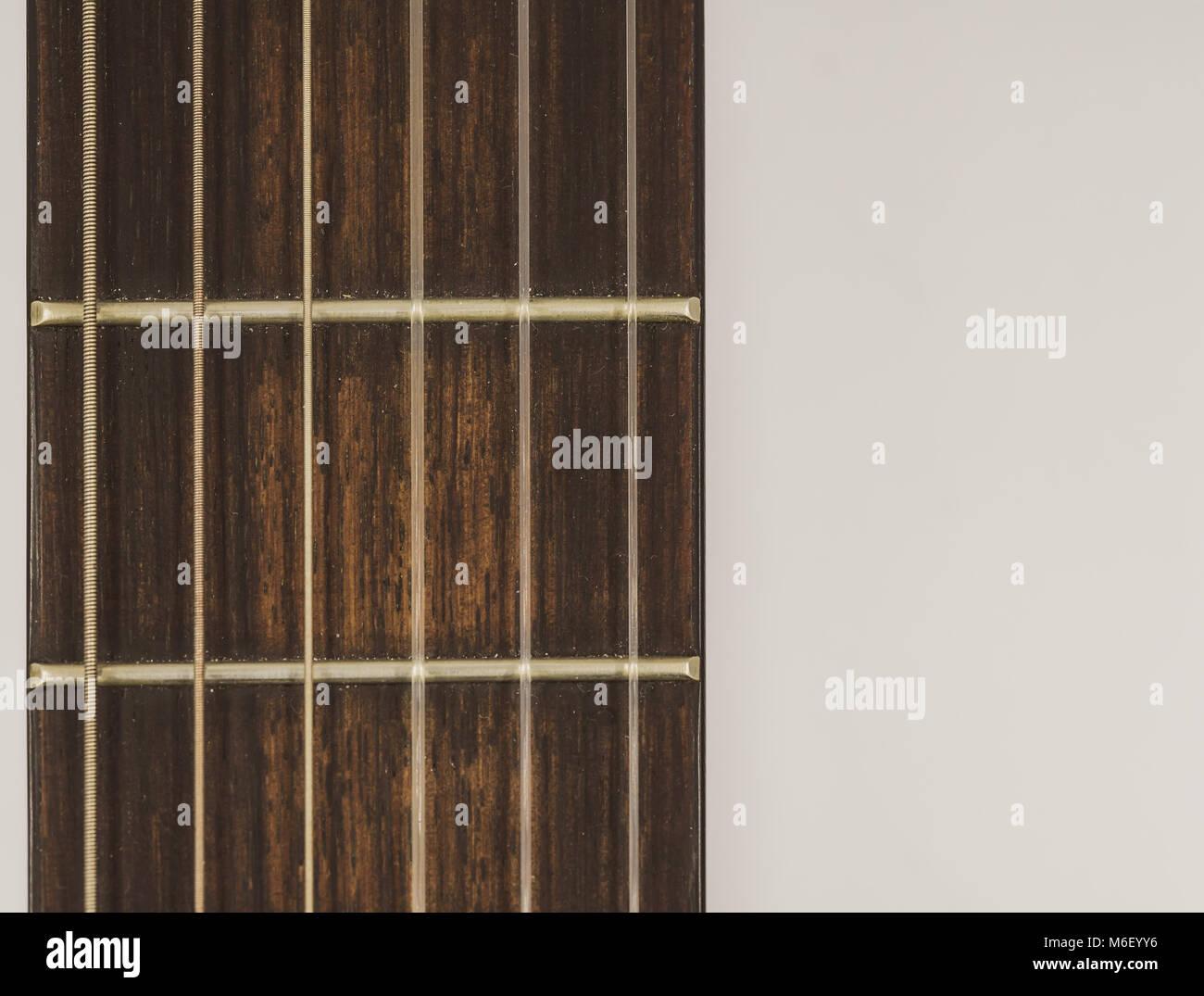 Nylon & steel strung spanish guitar neck isolated on white background - Stock Image
