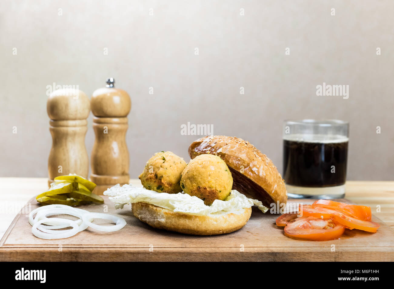 Vegan burger ingredients on wood table - Stock Image