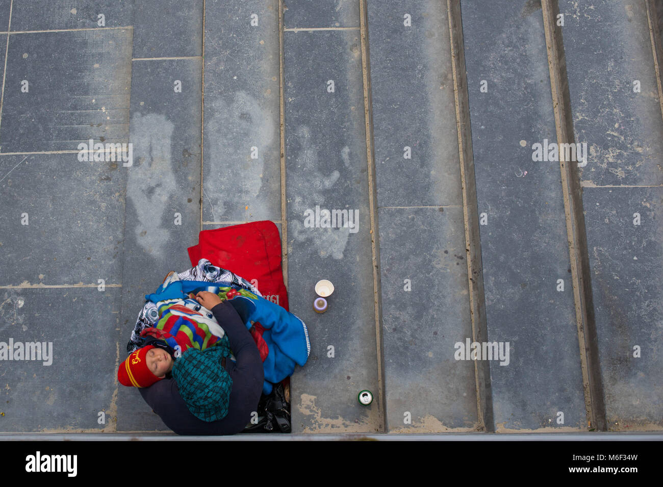 Bruxelles, mother with child begging. Belgium. - Stock Image