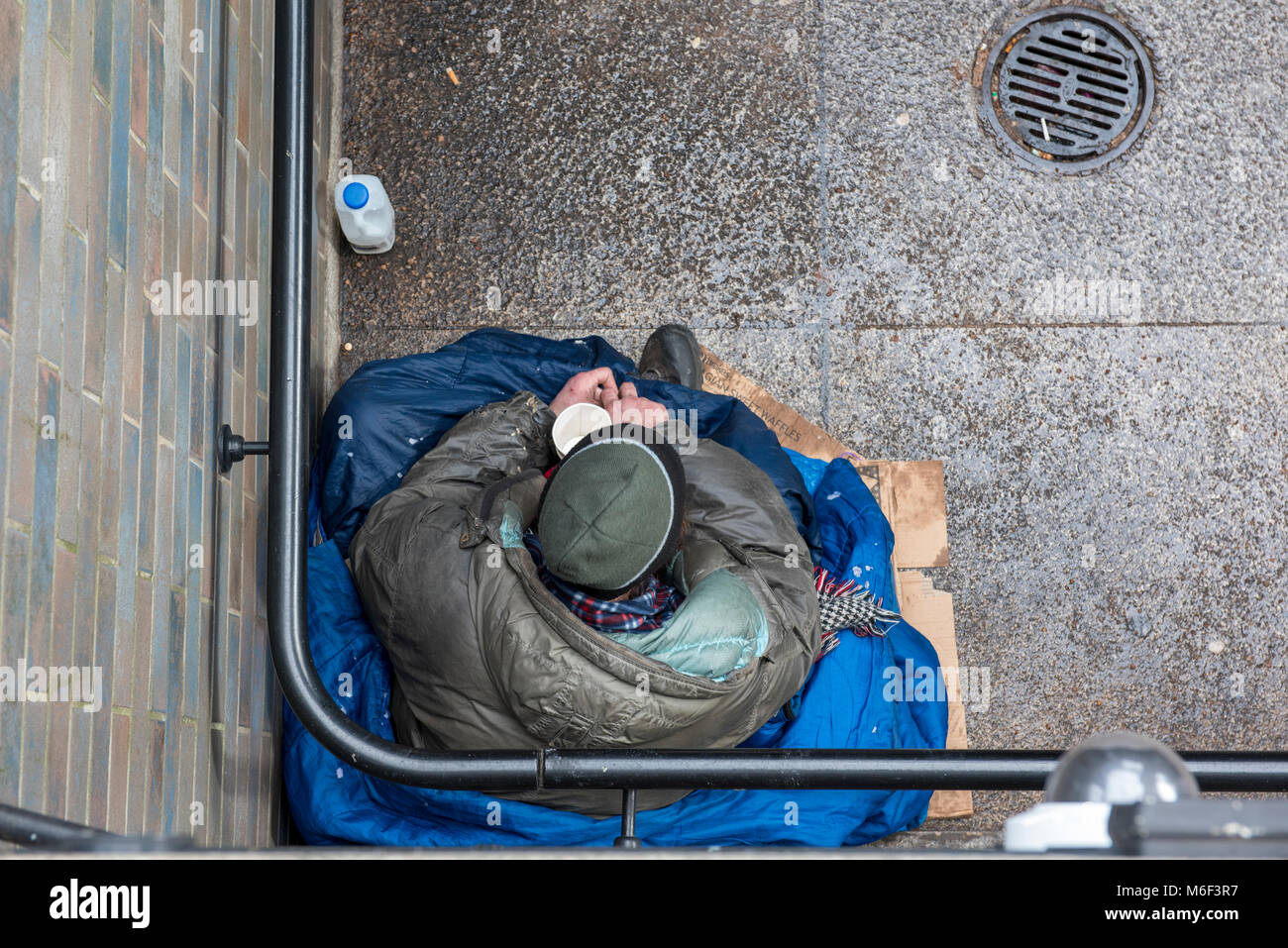a beggar or homeless man on the streets of the capital city london. homelessness and poverty in the UK. hopeless - Stock Image