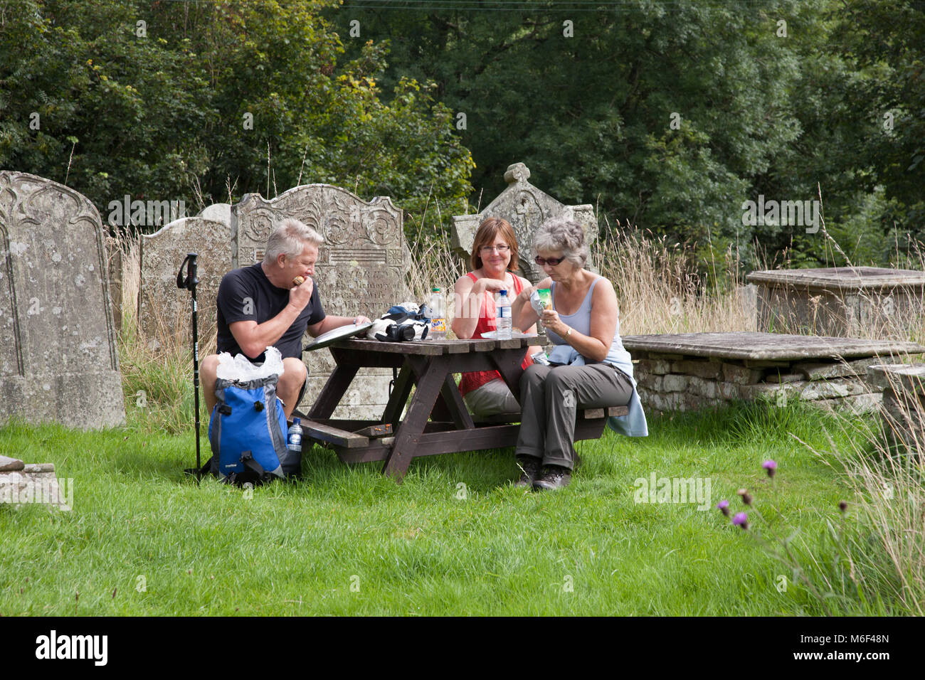 Walkers take advantage of free drinks and biscuits at St Mary's church at Newchurch Montgomery while walking on Stock Photo