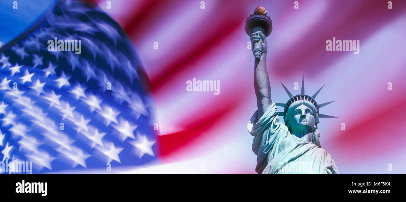 Statue of Liberty, and the Stars and Stripes flags,Liberty Island New York, USA - Stock Image