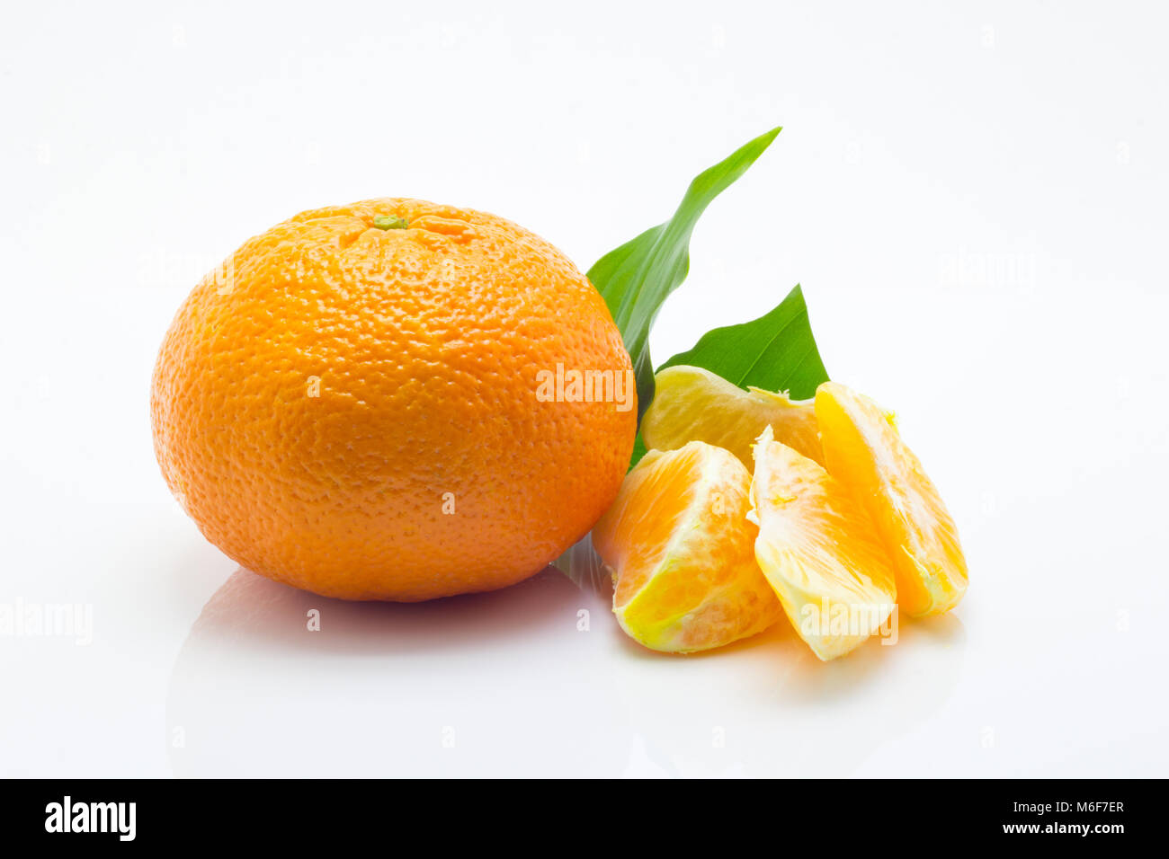 mandarin with green leaf isolated on white background - Stock Image