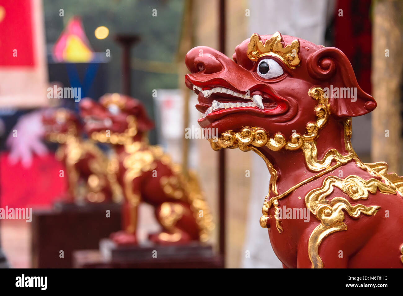 Stylised statues of dogs commemorate the start of the Year of the Dog Chinese New Year in Hanoi, Vietnam - Stock Image