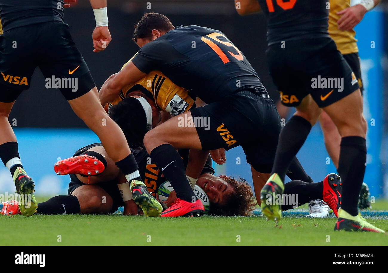 Buenos Aires, Argentina. 03rd Mar, 2018. Bautista Escurra (C, bottom) of Argentina Jaguars vies for the ball with - Stock Image