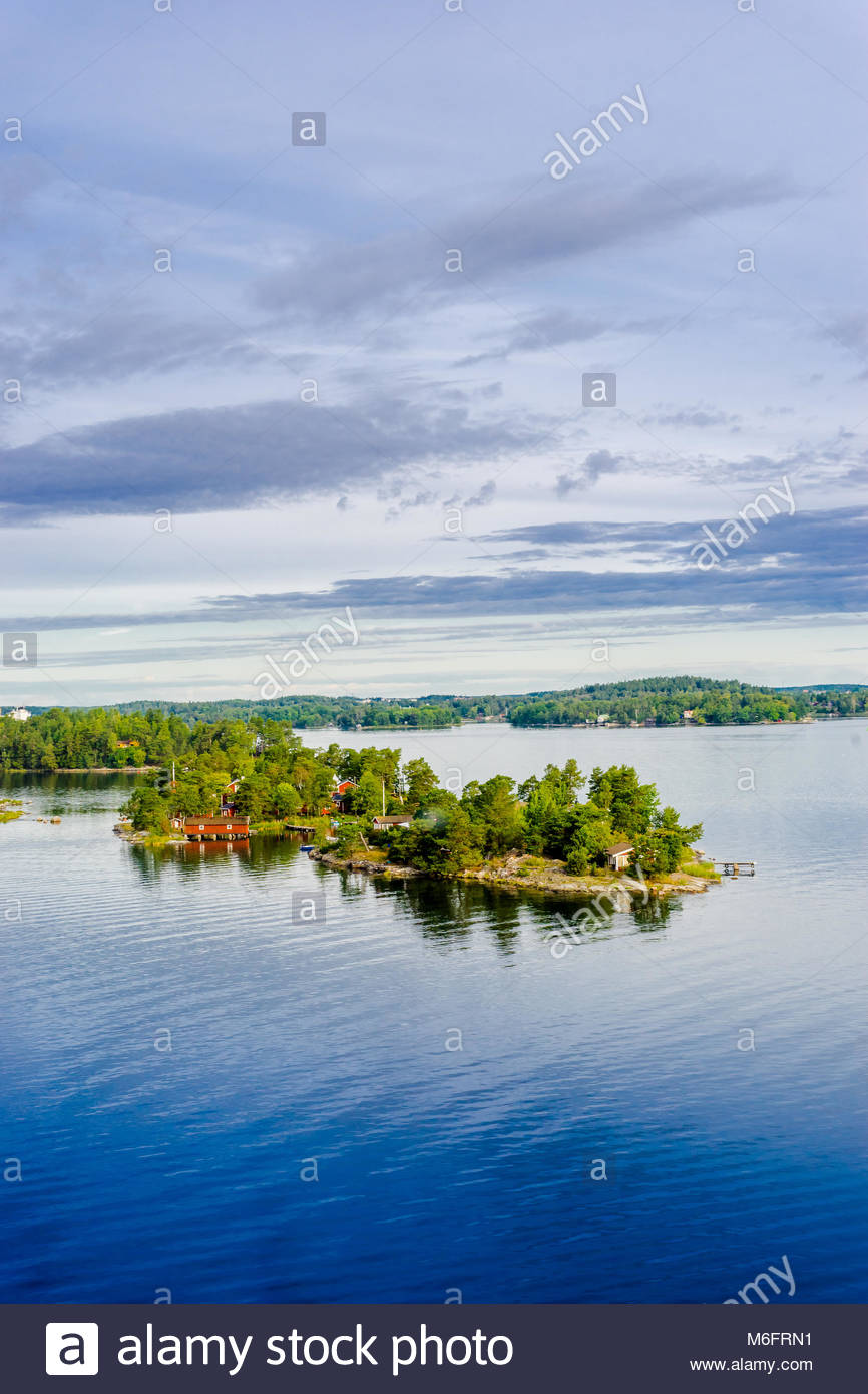 Beautiful super wide-angle panoramic aerial view of Stockholm archipelago, Sweden. Red little houses and green nature. - Stock Image