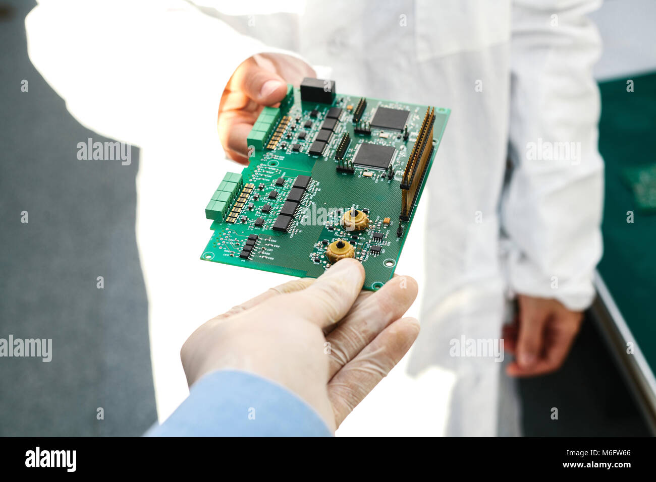 Computer Parts Conceptual Stock Photos Circuit Board Technician With Chips Spare And Components For Equipment